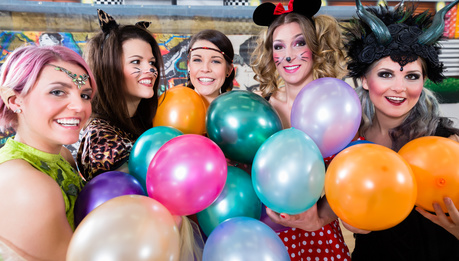 Group of women at Rose Monday making party with balloons