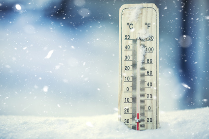 Thermometer on snow shows low temperatures under zero. Low temperatures in degrees Celsius and fahrenheit. Cold winter weather twenty under zero